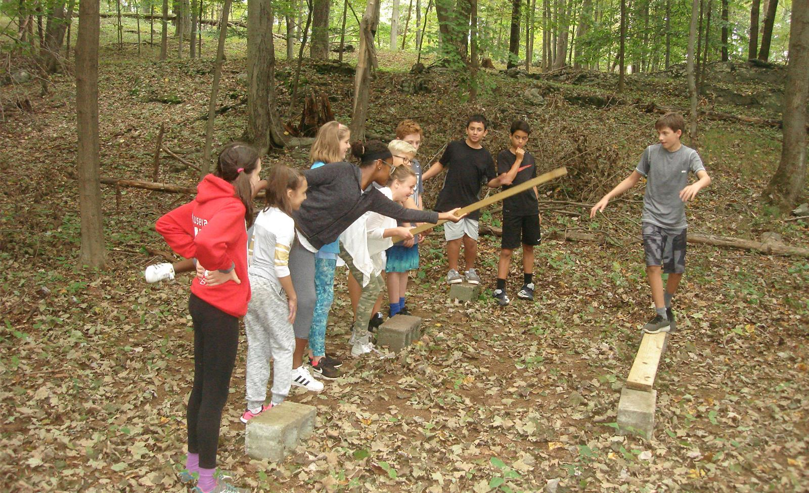 Seventh-Graders Work Together Through Obstacle Course Challenges photo