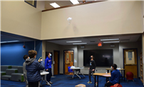 Seventh Graders Test Parachute Designs From Library Balcony thumbnail179565